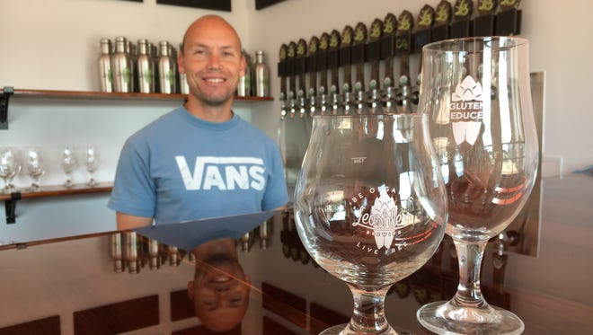 Founder John Gonzales poses behind the taproom counter at Leashless Brewing Co. in downtown Ventura. The brewery will open July 8 with gluten-reduced options among its certified-organic, Belgian-style beers.