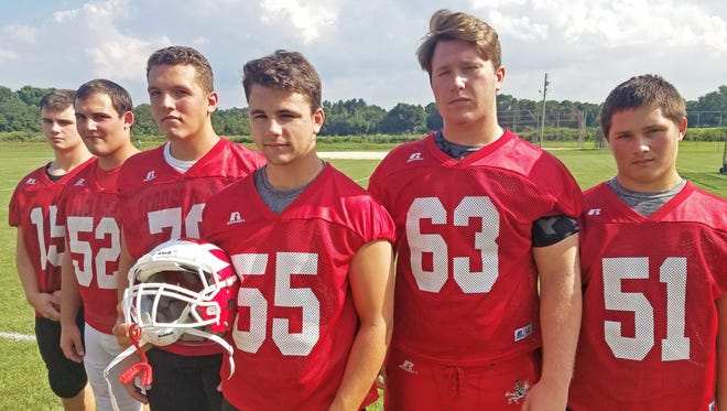 Delsea's offensive line, from left, of tight end Max Crawford, right tackle Joe Travers, right guard Will Sneathen, center Tommy Maxwell, left guard Colin Poisker and left tackle Nick Caudill will pave the way for the Crusaders' ground game this season.