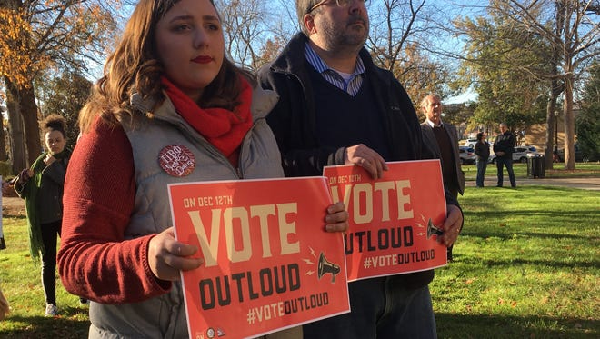 Emily Allegrezza and her dad. Jeff, both from Birmingham attend NAACP rally.on Sunday that was part of efforts to get out the vote for Tuesday's Senate race