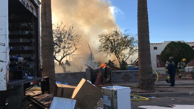 One person was killed and another wascritically injured in a natural gas explosion and firethat destroyed a home and knocked down power linesThursday morning in Phoenix.