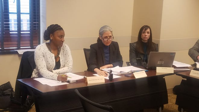 Council Board of Ethical Conduct members Mariah Cole, left, and Diane Di Ianni, center, discuss the ethics complaint filed against former Mayor Megan Barry at a hearing March 7, 2018, in Nashville.