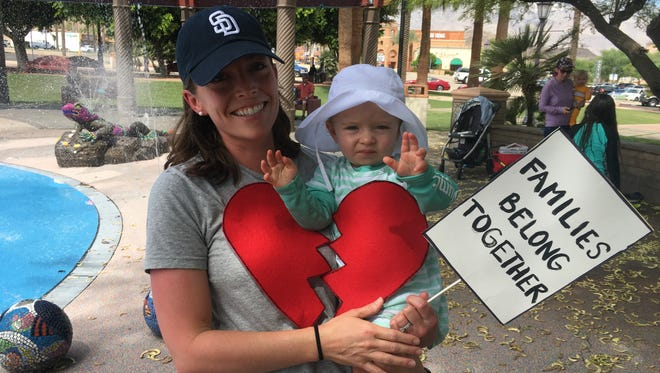 Jessica Bookland of Palm Desert and her daughter Aella attended an event calling on the Trump Administration to end family separation at the border.