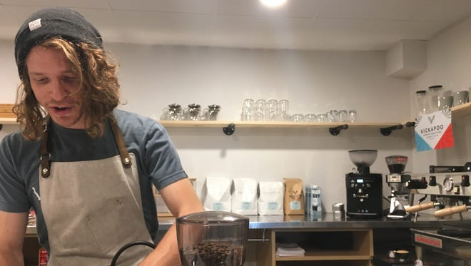 Foster Douglas runs Cura Coffeehouse, a new cafe located on the third floor of the Brown County Library on Pine Street.