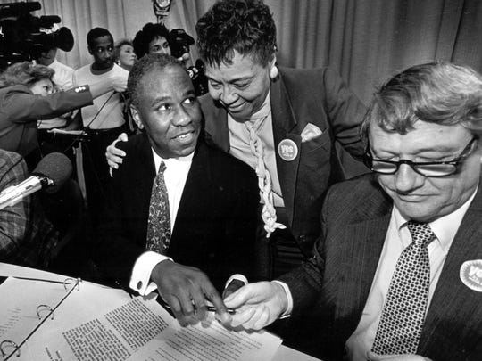 Dr. Willie Herenton, center suprintendant of Memphis City Schools, is consoled by school board member Maxine Smith after announcing his retirement plans for the end of the school year October 29, 1990 . At left is board member Hubon Sandridge and at right is school board president J.C. Williams.