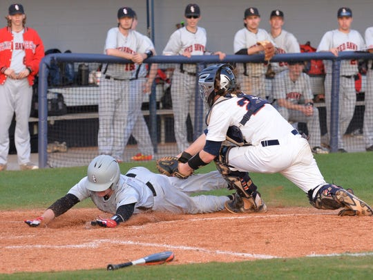 Blackman catcher Peyton Milam tags out Stewarts Creek's Brandon Dial in the third inning Wednesday. Stewarts Creek defeated the Blaze 3-0.