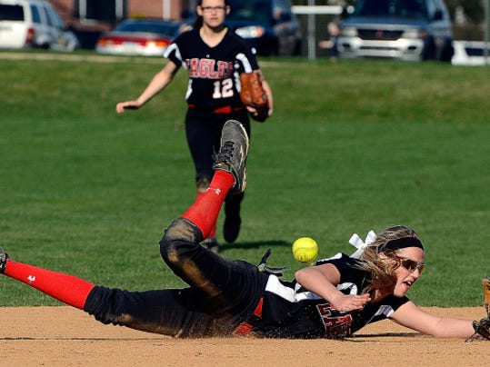 Dover second baseman Meghan Goodman makes a diving attempt to stop a hard-hit West York grounder on Monday. Dover won the game, 5-3.