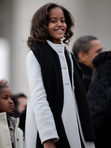 Malia Obama, then 10, and President Barack Obama smile