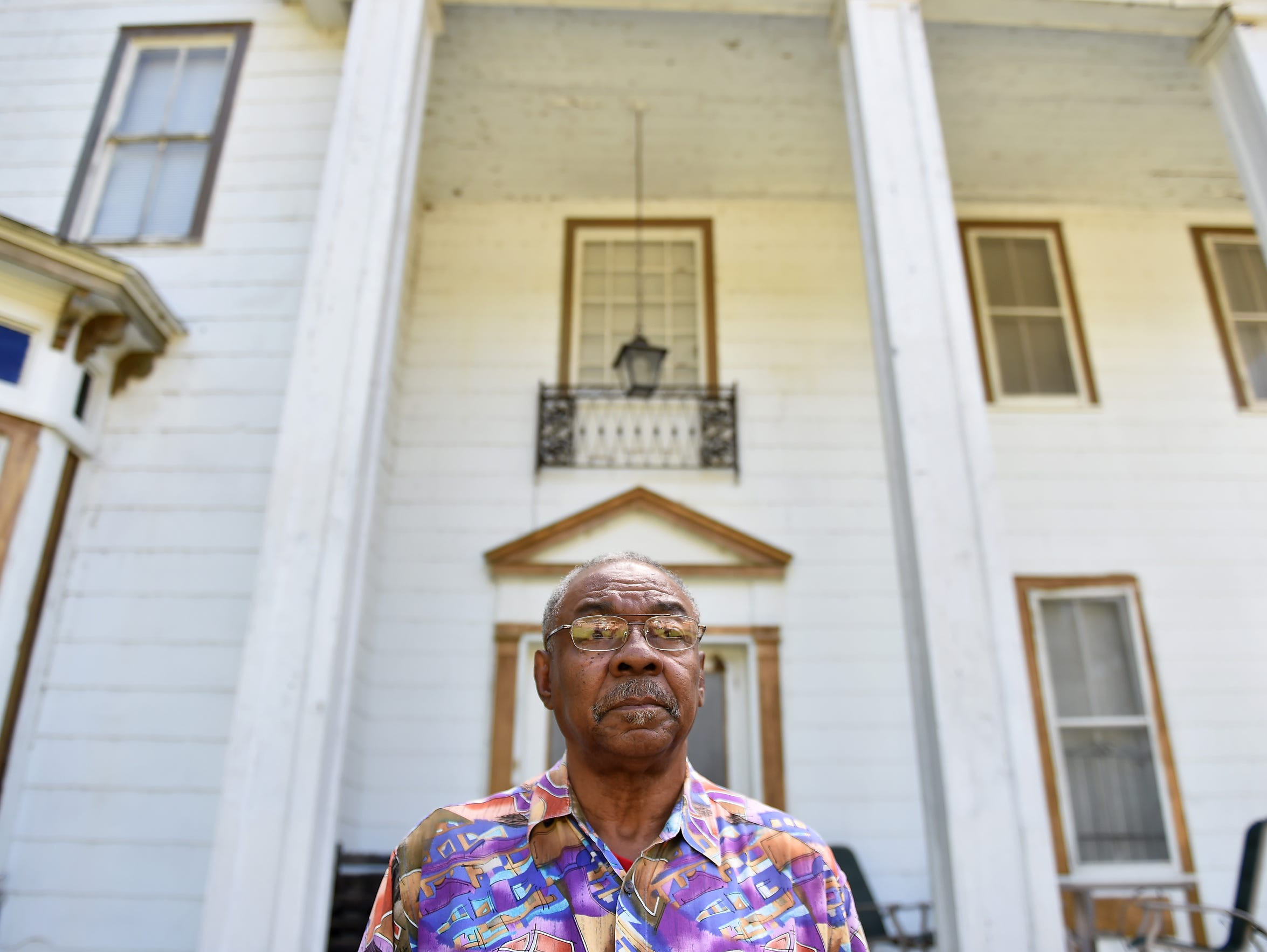 Eddie Carthan stands outside his home in Tchula in