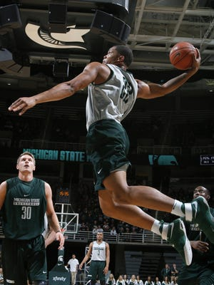 Miles Bridges goes up for a windmill dunk Oct. 14, 2016 in East Lansing during Midnight Madness.
