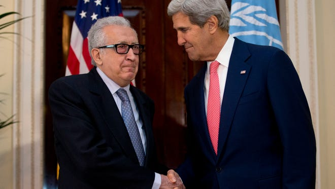 U.N-Arab League envoy for Syria Lakhdar Brahimi, left, shakes hands with U.S. Secretary of State John Kerry after their meeting at Winfield House, the residence of the U.S. Ambassador to Britain, in London, Monday, Oct. 14, 2013. Kerry and Brahimi said Monday that an international conference to set up a Syrian transitional government must be organized urgently and held as soon as possible. (AP Photo/Jacquelyn Martin, Pool)