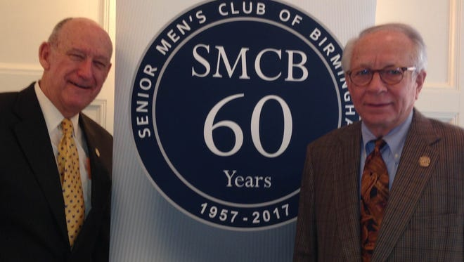 Dick Bradley (left) and Dick Kamp surround the logo for the Birmingham Senior Men's Club. Bradley is coordinating  all of the special events for this 60th Anniversary year. Dick Kamp is the president of the club, which plays an important role in the lives of the 600-plus members who meet weekly at the Community House.