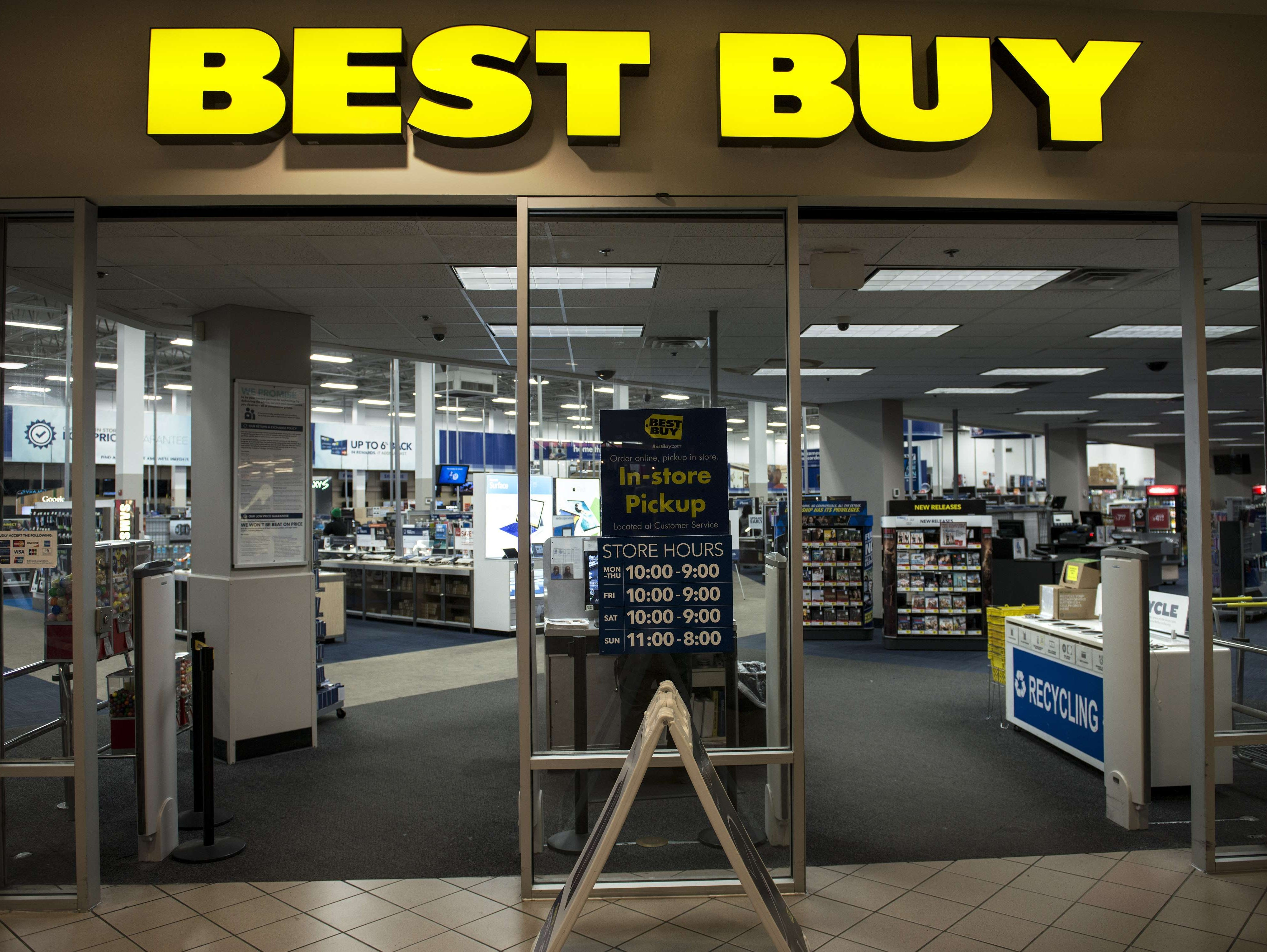 This September 25, 2014 file photo shows an entrance to a Best Buy store in Arlington, Virginia.   US home appliance giant Best Buy is leaving the Chinese market, selling its Five Star subsidiary there to a local group, the company said December 4, 2