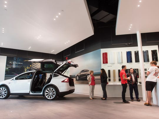 Customers and staff at the new Tesla store at Waterside Shops in Naples, Fla., on Dec. 20, 2016.