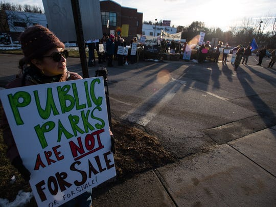 Jane Palmer of Monkton, a long-time opponent of a pipeline being build by Vermont Gas through Addison County, protests outside their office in South Burlington Wednesday, Feb. 8, 2017.