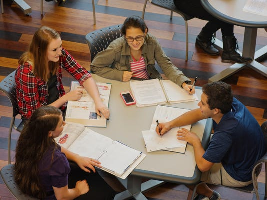 636256982406982237-Students-at-table-in-Student-Center.jpg