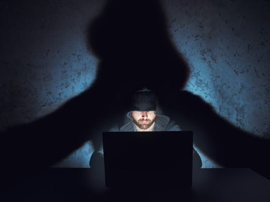 Man hacker works in dark empty room