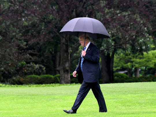 President Trump walks towards Marine One while departing