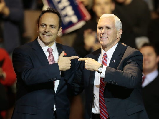 Kentucky Gov. Matt Bevin (left) and Vice President-elect Mike Pence (right) at U.S. Bank Arena Thursday.