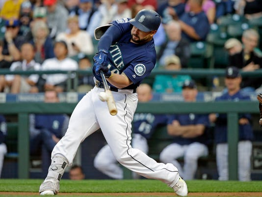 FILE - In this Aug. 14, 2017, file photo, Seattle Mariners' Yonder Alonso doubles against the Baltimore Orioles in the first inning of a baseball game in Seattle. A person familiar with the negotiations says free-agent first baseman Yonder Alonso and the Cleveland Indians have agreed to contract terms. Alonso's deal is contingent on him passing a physical, according to a person who spoke to The Associated Press on condition of anonymity Thursday because the agreement had not been announced. (AP Photo/Elaine Thompson, File)
