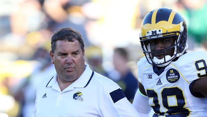 Michigan Wolverines coach Brady Hoke stands next to quarterback Devin Gardner (98) before the game against the Notre Dame Fighting Irish at Notre Dame Stadium.