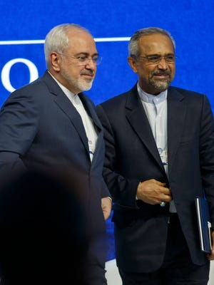 """Iranian Foreign Minister Mohammad Javad Zarif, left, and Iranian Chief of Staff of the Presidency Mohammad Agha Nahavandian leave the stage after a  panel""""Next Steps for Iran and the World""""at the World Economic Forum in Davos, Switzerland, Wednesday, Jan. 20, 2016."""