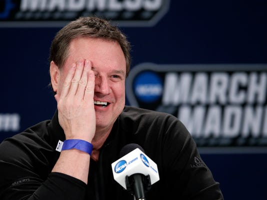 Kansas head coach Bill Self smiles during a news conference for their NCAA men's college basketball tournament second-round game against Seton Hall, Friday, March 16, 2018, in Wichita, Kan. (AP Photo/Orlin Wagner)