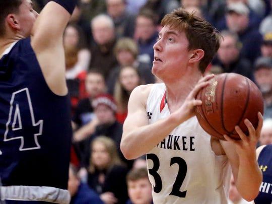 Pewaukee's Gabe Guidinger drives to the basket through
