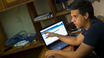 On Jan. 4, 2015, Rafael Antonio Broche Moreno in Havana uses a computer that is disconnected from the real Internet because of Cuban government control.