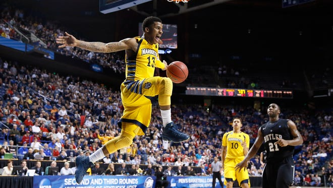 Vander Blue reacts after a steal and a dunk for Marquette against Butler in the 2013 NCAA Tournament.