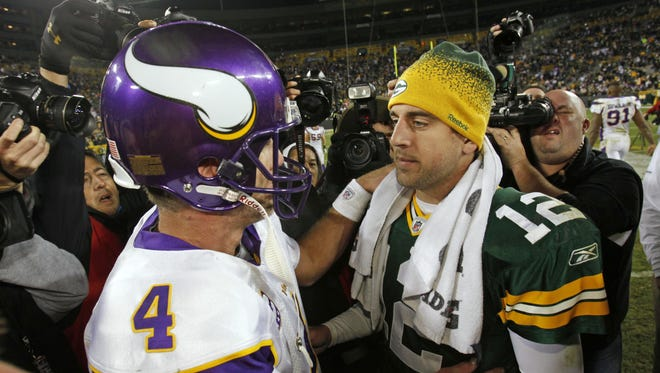 Brett Favre (4) started 16 games at age 40 in 2009, including a 38-26 victory at Lambeau Field over Aaron Rodgers (12) and the Green Bay Packers.