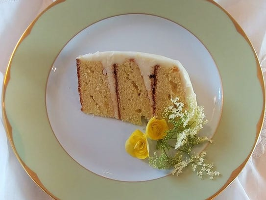 Lemony buttercream icing is spread between the layers, on the sides and finally on top of the Lemon Elderflower Cake.