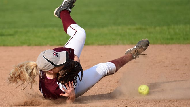 Newark second baseman Alexis Powelson attempts a diving catch against Groveport on Friday, April 14, 2017. The Wildcats lost to the Cruisers 6-1.