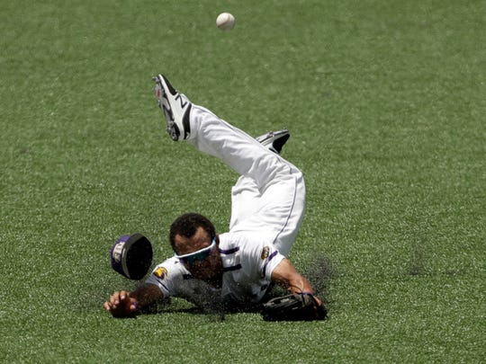 Tennessee Tech outfielder Collin Harris (1) misses the ball as he dives for a hit by Texas pitcher Ryan Reynolds (5) in the second inning of an NCAA college super regional baseball game, Sunday, June 10, 2018, in Austin, Texas. (AP Photo/Eric Gay)