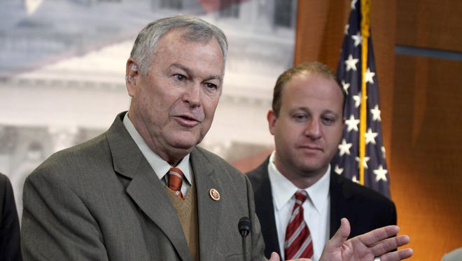 Rep. Dana Rohrabacher, R-Calif., left, accompanied by Rep. Jared Polis, D-Colo., speaks during a news conference on Capitol Hill in Washington, Thursday, Nov, 13, 2014, to discuss marijuana laws. Members of Congress from states with legal pot are banding together to tell their colleagues on Capitol Hill not to interfere with state drug laws. (AP Photo/Lauren Victoria Burke)