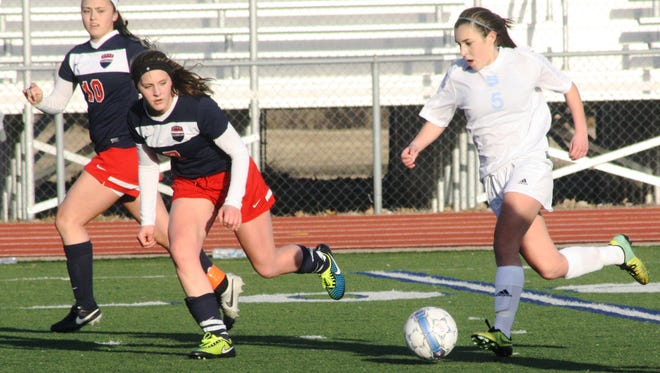 Stevenson's Megan Verant pushes the ball up the field Tuesday night against Franklin.