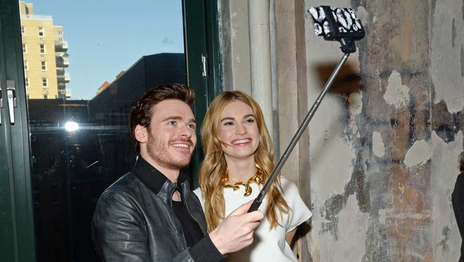 """Actors Richard Madden and Lily James take a selfie while attending AOL's BUILD Speaker Series to discuss their new film """"Cinderella"""" at AOL Studios in New York City."""