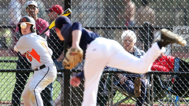 Dunellen takes on East Brunswick Tech in a varsity baseball game in Dunellen on Friday April 17,2015.Batter # 5 (left) East Brunswick's # 5 Vincent Pellicane keeps his eye on the ball as Dunelle pitcher # 5 (right) David Johnson tries to haul the ball by him.