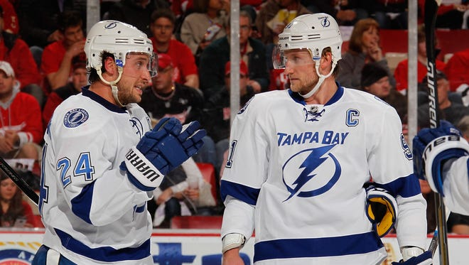 Steven Stamkos, right, of the Tampa Bay Lightning talks with teammate Ryan Callahan during the first period against the Detroit Red Wings in Game 4 at Joe Louis Arena on Thursday, April 23, 2015.