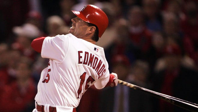 Jim Edmonds of the St. Louis Cardinals watches his two-run walk-off home run against the Houston Astros in Game 6 of the National League Championship Series October 20, 2004 at Busch Stadium in St. Louis.