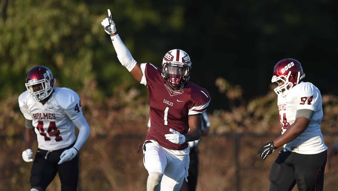 Hinds receiver Javon Wims (1) celebrates his touchdown reception against Holmes on Thursday, August 27, 2015, at Hinds Community College in Raymond, Miss.