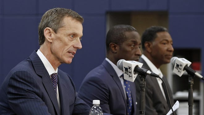 Minnesota Timberwolves assistant coach Sam Mitchell, right, listens as CEO Rob Moor, left, names Mitchell interim head coach, while head coach Flip Saunders takes a leave of absence, during a news conference Friday in Minneapolis. Saunders, who had been undergoing chemotherapy treatment after being diagnosed with Hodgkin lymphoma earlier this summer, is hospitalized while undergoing further testing and treatment. Listening, center, is general manager Milt Newton.