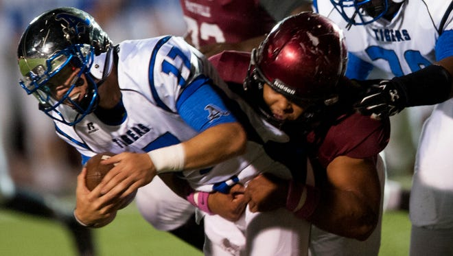 Prattville's Dyterious Johnson tackles Auburn quarterback Bradley Northcutt (17) in Prattville, Ala. on Friday October 16, 2015.