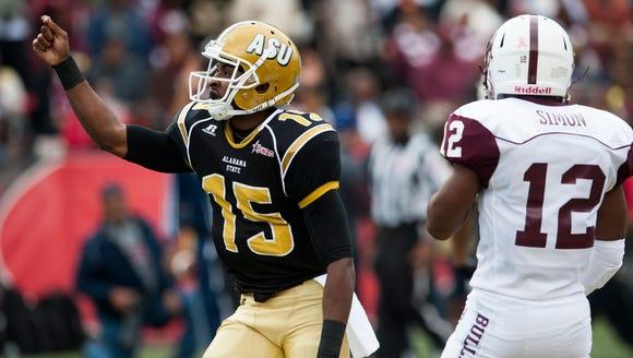 Alabama State quarterback DanielDuhart (15) celebrates