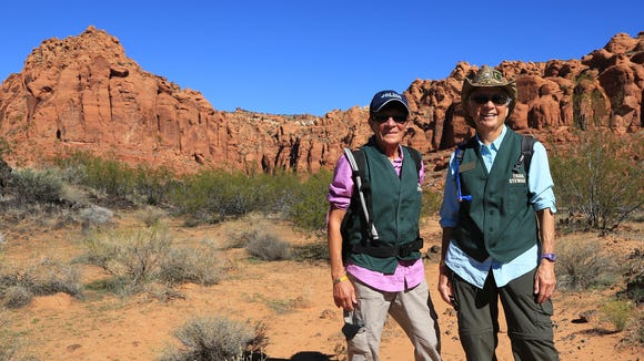 Patt Kinner and Janice Heller, trail stewards for the Friends of Snow Canyon, patrol the Scout Cave Trail in the state park.