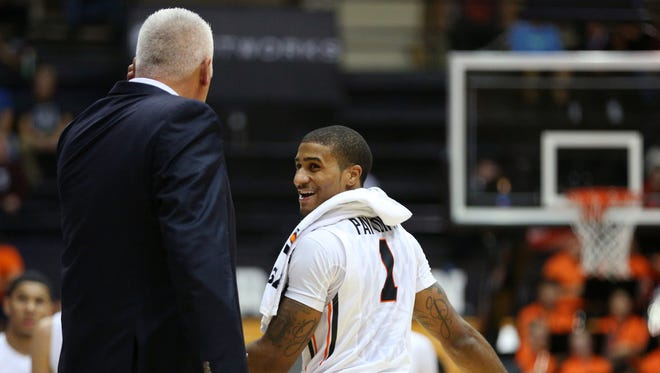 Oregon State guard Gary Payton II (1) laughs with coach Wayne Tinkle against Western Oregon inside Gill Coliseum, Thursday, November 5, 2015, at Oregon State University in Corvallis, Ore. Oregon State won the game 76-57.