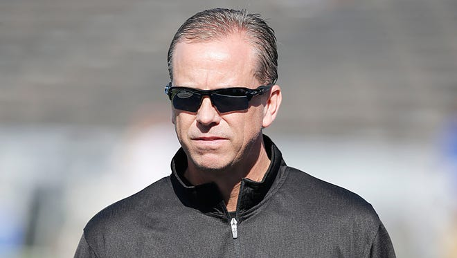 Southern Miss head coach Todd Monken watches his team warm up before playing against Rice on Saturday at Rice Stadium in Houston, Texas.