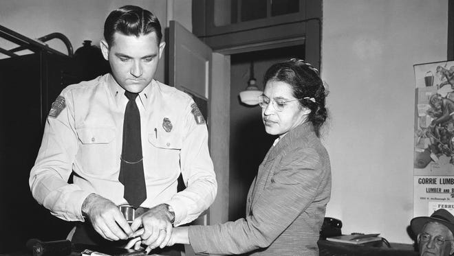 In this Feb. 22, 1956, file photo, Rosa Parks, whose refusal to move to the back of a bus, touched off the Montgomery bus boycott and the beginning of the civil rights movement, is fingerprinted by police Lt. D.H. Lackey in Montgomery, Ala. She was among some 100 people charged with violating segregation laws. The 60th anniversary of the Montgomery bus boycott is widely credited with helping spark the modern civil rights movement.