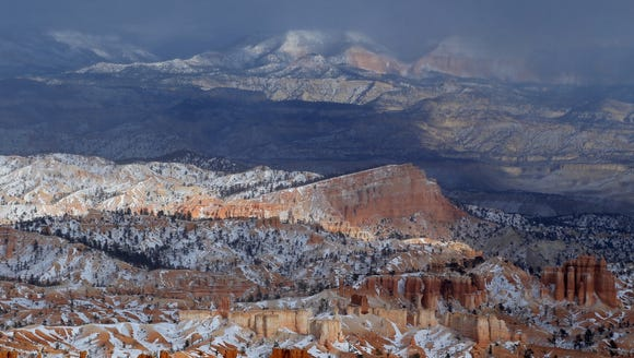 A storm shrouds mountains to the east of Bryce Canyon