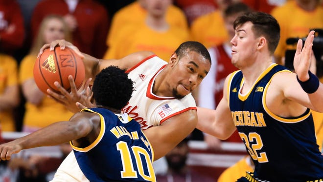 Nebraska's Ed Morrow (30) is defended by Michigan's Derrick Walton Jr. (10) and Ricky Doyle (32) during the first half of an NCAA college basketball game in Lincoln, Neb., Saturday, Jan. 23, 2016.