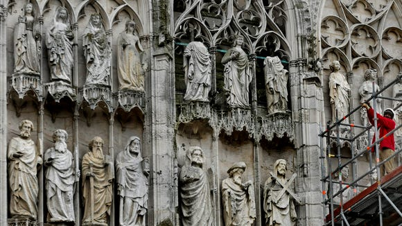 Renovating the saints at the Rouen Cathedral.